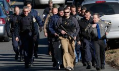 police-patrol-the-streets-outside-sandy-hook-elementary-school-after-a-deadly-school-shooting-in
