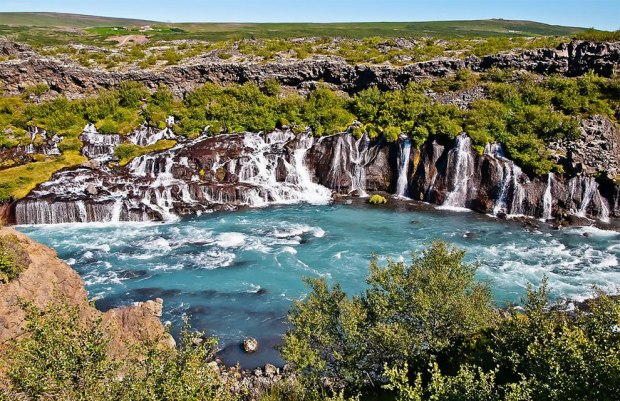 In-western-Iceland-water-flows-about-2953-ft-900-m-through-a-lava-field-and-emerges-to-form-a-series-o