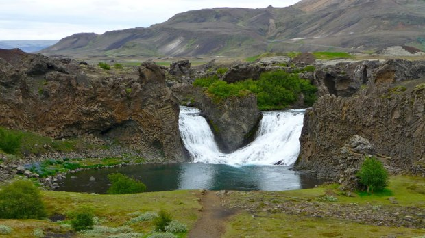June-at-Hjálparfoss-waterfall-in-south-Iceland