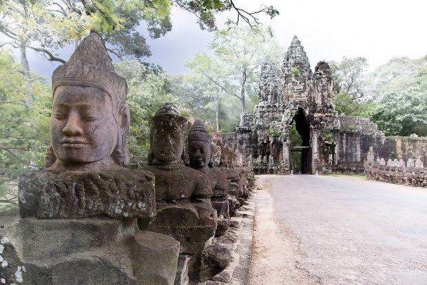 Mythic-statues-line-the-causeway-over-a-moat-leading-to-the-south-gate-of-Angkor-Thom