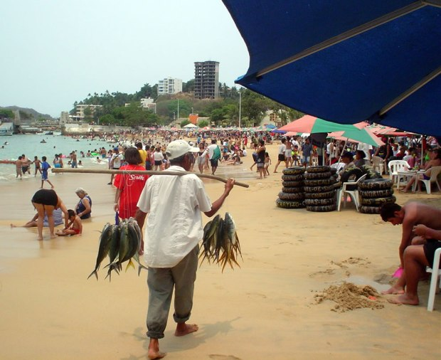 Vendor-with-fish-at-Playa-Caleta